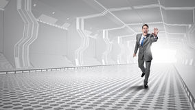 Man running and reaching hand Royalty Free Stock Photo