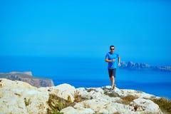 Man running on the rock Stock Photos