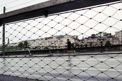 Man running in Salzburg Austria on a cloudy day royalty free stock photos