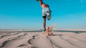 Man Running on Sand royalty free stock photography
