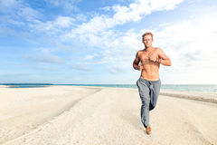 Man running on sand of tropical beach Royalty Free Stock Photos
