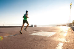 Man running at the seaside. Stock Photography