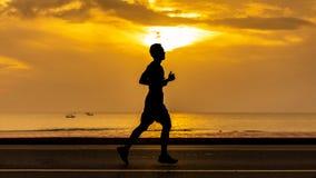 Man running at seaside road Stock Photos