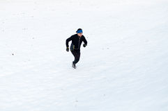 Man running on the snow Royalty Free Stock Image