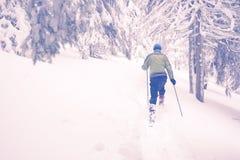 Man running snowshoeing in deep snow Royalty Free Stock Image