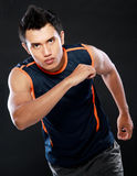 Man running. Sportive man running and looking very competitive Royalty Free Stock Image