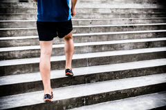 Man running on stairs, jogger Royalty Free Stock Photos