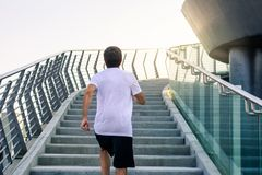Man running on the stairs during a workout. Man running on the stairs during an outdoors workout royalty free stock photos