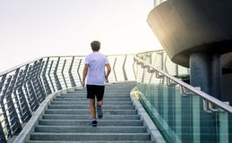Man running on the stairs during a workout. Man running on the stairs during an outdoors workout royalty free stock image