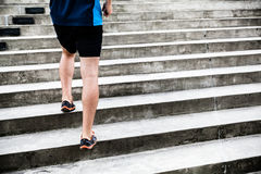 Man running on stairs, training Stock Photos