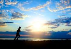 Man running at Sunset Stock Photos