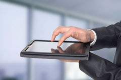 Man running on the tablet. Close-up Royalty Free Stock Photos