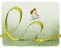 Man running on tape measure Stock Image