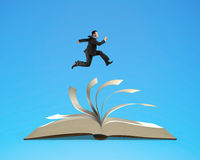 Man running on top of flipping pages of open book. Isolated in blue background, 3D rendering Royalty Free Stock Photos