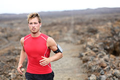 Man running - trail runner training Stock Images