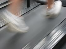 Man running on treadmill Stock Photos