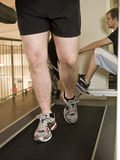 Man running on a treadmill Stock Photos