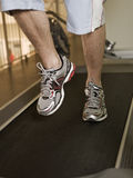 Man running on a treadmill Stock Image