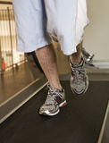 Man running on a treadmill Royalty Free Stock Image