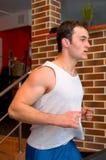 Man running on the treadmill Stock Photo