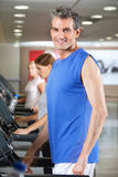 Man running on treadmill in gym Royalty Free Stock Image