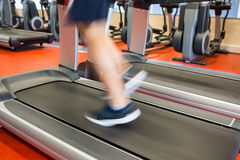 Man running on a treadmill Royalty Free Stock Photo