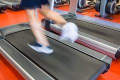 Man running on a treadmill Stock Photos
