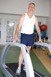 Man Running On Treadmill At Gym Stock Images