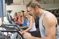 Man Running On Treadmill At Gym stock photography