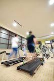 Man running on treadmill in gym Royalty Free Stock Photos