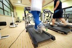 Man running on treadmill in gym Royalty Free Stock Photos