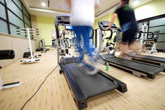 Man running on treadmill in gym. Man running on treadmill at fitness  gym Royalty Free Stock Image