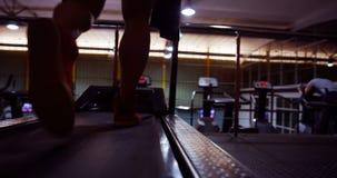 Man running on the treadmill stock footage