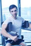 Man running on the treadmill Stock Photos