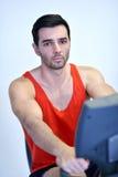 Man running on the treadmill Royalty Free Stock Image