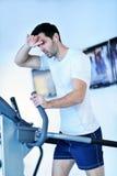 Man running on the treadmill Stock Photography
