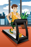 Man running on treadmill Royalty Free Stock Photos
