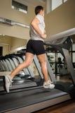 Man running on treadmill Royalty Free Stock Images