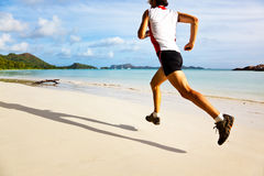 Man running on a tropical beach Stock Images