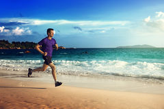 Man running on tropical beach Royalty Free Stock Photos