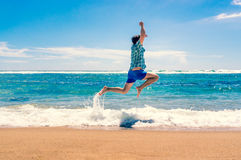 Man running on tropical beach Royalty Free Stock Photo