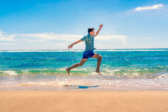 Man running on tropical beach Royalty Free Stock Photography