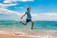 Man running on tropical beach Stock Photo