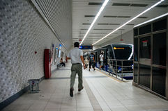 Man running trying to catch the Istanbul metro train at Kabatas Royalty Free Stock Photography