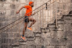Free Man Running Up Outdoor Stairs Stock Photos - 213976063