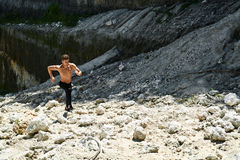 Man Running Up Rocky Hill, Exercising During Outdoor Workout. Sport Royalty Free Stock Photos