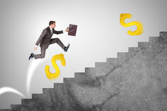 Man running up stairs with gold dollar signs Royalty Free Stock Photo