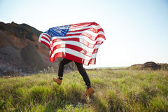Man Running with USA Banner in Nature Stock Image