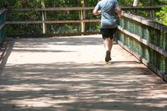 Man Running on Walkway in the Park in a Hot Day. On Blur Background. Turkey Creek, Niceville, Florida stock photos
