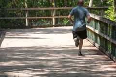 Man Running on Walkway in the Park in a Hot Day. On Blur Background. Turkey Creek, Niceville, Florida stock photography